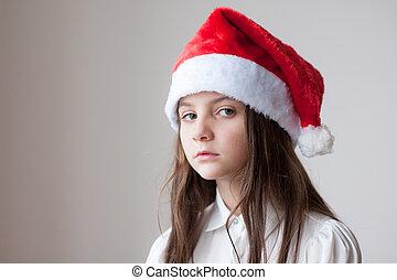 c838f7e87085e Beautiful smiling little girl in santa cap. Beautiful smiling young ...