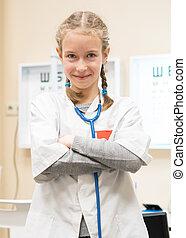 Cute little girl in doctor uniform.