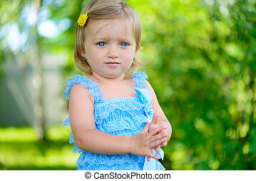 Cute little girl in dress at park