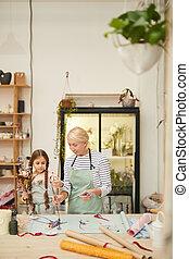 Cute Little Girl in Florists Workshop