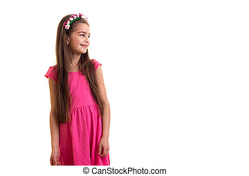 Cute little girl in pink dress at white background