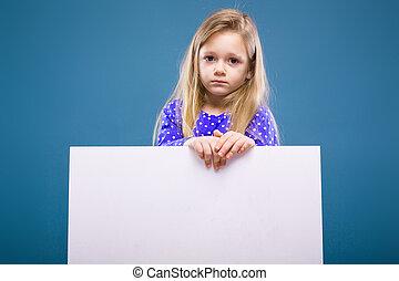 Cute little girl in purple dress holds empty poster