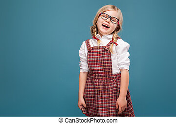 Cute little girl in red dress, white shirt and glasses