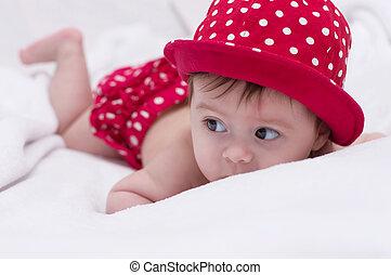 Cute little girl in red hat