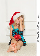 little girl in the santa claus hat