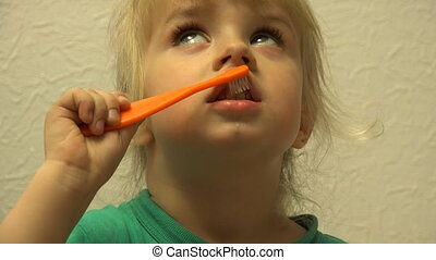 Cute Little Girl is Cleaning Teeth Using Toothbrush