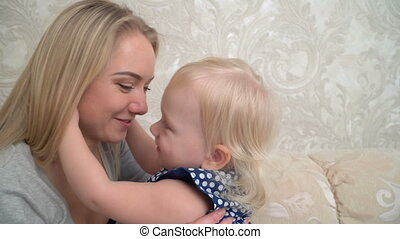 Cute little girl is hugging her mother