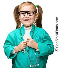 Cute little girl is playing doctor