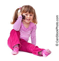 Cute little girl is talking on cell phone, isolated over white