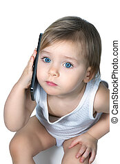 Cute little girl is talking on smartphone