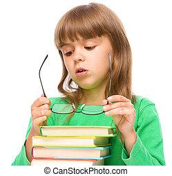 Cute little girl is wearing glasses