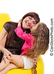 Cute little girl kiss her smiley mother