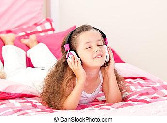 Cute little girl listening music