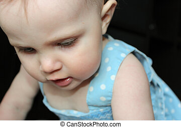 Cute little girl looking down