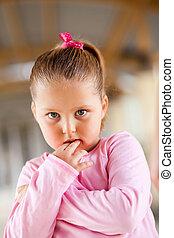 cute little girl looks scared