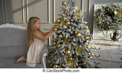 Cute little girl near Christmas tree