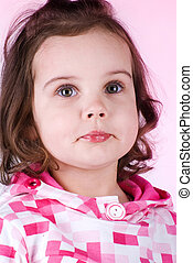 Cute little girl on pink