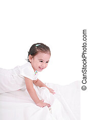 cute little girl on the bed at home