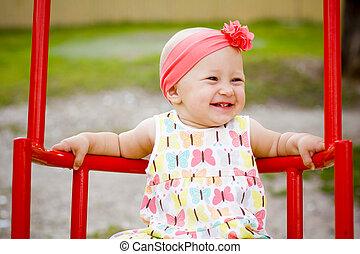 Cute little girl on the swings