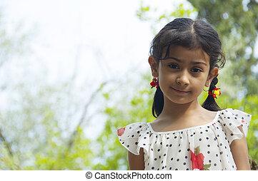 Cute little girl outdoor  in summer day