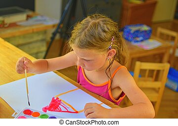 Cute little girl painting picture of house. Mortage concept