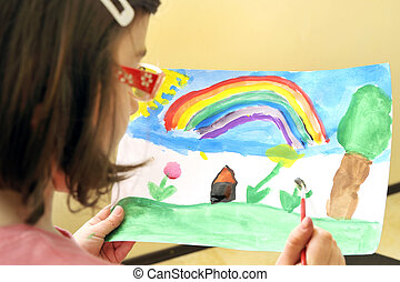 cute little girl painting with watercolor