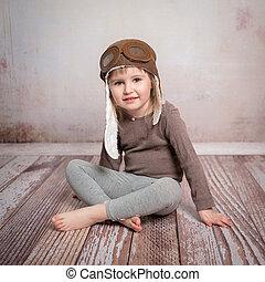 cute little girl-pilot in hat
