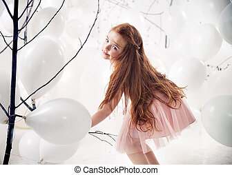 Cute little girl playing balloons