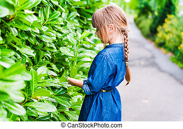Cute little girl playing outdoors