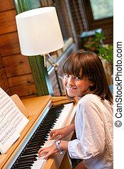 Cute little girl playing piano.