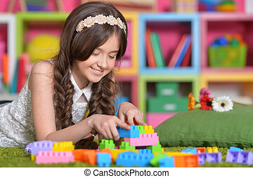 girl playing with colorful blocks