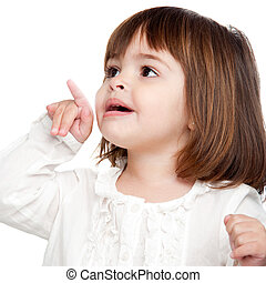 Cute little girl pointing with finger