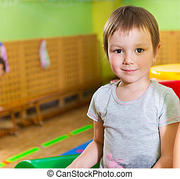 Cute little girl portrait in daycare