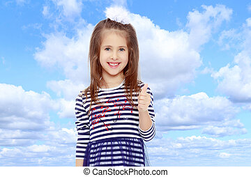 Cute little girl posing in front of the camera.