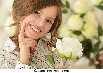 cute little girl posing  with flower
