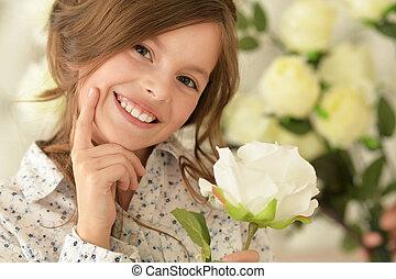cute little girl posing  with flower