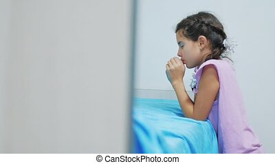Cute little girl praying at home. little girl prays in the evening before bedtime bed. little girl lifestyle and religion concept Faith in God