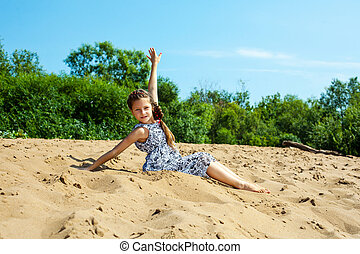 Cute little girl resting on beach