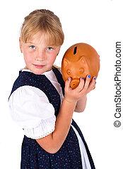 Cute little girl saving money in a piggy-bank