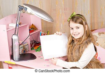 Cute little girl showing blank paper
