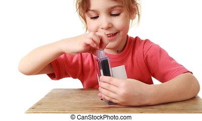 little girl shows focus transforming paper into euros - cute...