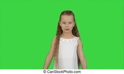 Cute little girl singing a song and dancing on a Green Screen, Chroma Key