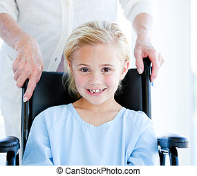 Cute little girl  sitting on a whel