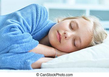 Cute little girl sleeping in bed