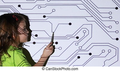 little girl stand in front of projector screen and move pen...