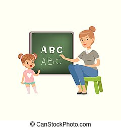 Cute little girl standing near the blackboard and writing letters of the English alphabet, teacher helping her, language class in primary school, preschool education vector Illustration