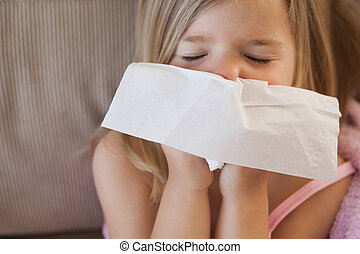 Cute little girl suffering from cold