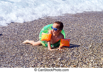 Cute little girl swimming in the sea