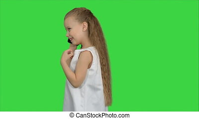 Cute little girl talking on the cell phone on a Green Screen, Chroma Key