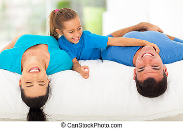 cute little girl tickling her father